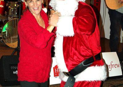 Maureen and Santa at the Holly Jolly Radiothon