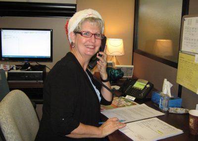 Volunteer- Cathy Dick answering phone at Radiothon